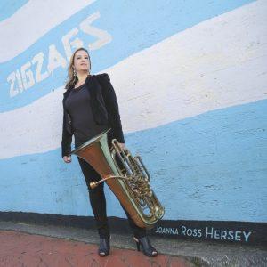 Joanna standing with tuba