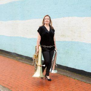 Joanna walking with tubas